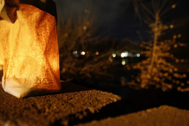 A luminaria glows in Berg Park during the 2018 Riverglo celebration. The event returns to the park on Dec. 6.