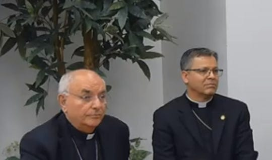 Bishop Gerald R. Barnes, 74, left, and Bishop Alberto Rojas, 54, take questions from the media at a news conference on Monday, Dec. 2, 2019, in San Bernardino. Rojas was introduced as the coadjutor bishop of the Roman Catholic Diocese of San Bernardino. He'll automatically become bishop when Barnes retires on his 75th birthday next June.