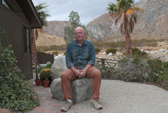 Wayne King, who lives near the Whitewater Preserve, is concerned that the large turbines proposed for the top of the hilllsides in the background will disrupt the scenery and quiet in the Whitewater Canyon. Photo taken Nov. 27, 2019.