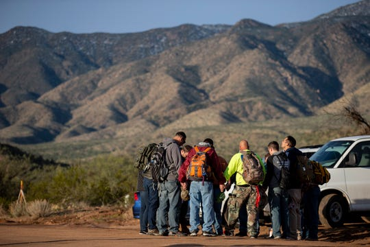 Volunteers pray on Dec. 2, 2019, before helping the search for the third missing child who was swept away from her family's truck in Tonto Creek in Tonto Basin on Nov. 29.