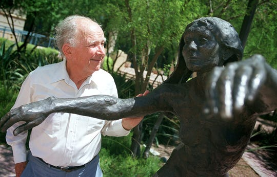 In this 2001 photo, sculptor John Henry  Waddell reminisces about the model he met in San Francisco that inspired this sculpture outside the Herberger Theater Center in Phoenix. Waddell died on Nov. 27, 2019.