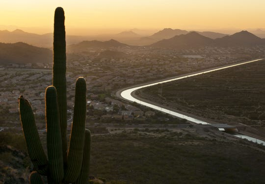 The CAP canal winds through a neighborhood on one side and the desert on the other in Phoenix as seen from the Deem Hills Recreation Area.