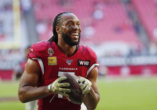 Arizona Cardinals wide receiver Larry Fitzgerald (11) jokes with fans before playing against the Los Angeles Rams at State Farm Stadium December 1, 2019.