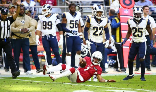 Arizona Cardinals quarterback Kyler Murray (1) is tackled by Los Angeles Rams cornerback Troy Hill (22) in the first half during a game on Dec. 1, 2019 in Glendale, Ariz.