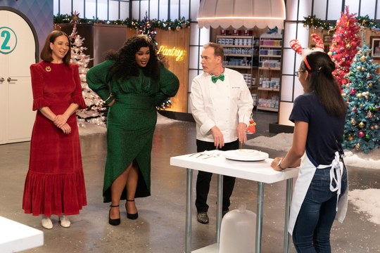 Judges question a contestant on the 2019 holiday season of Nailed It!, a Netflix baking show.