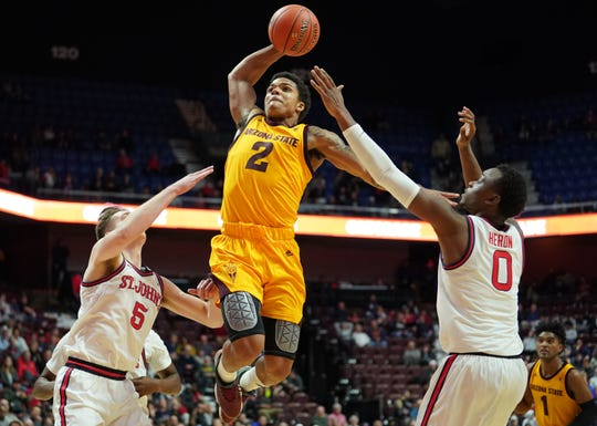 ASU guard Rob Edwards drives to the basket during a game against St. John's on Nov. 23.