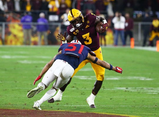 Arizona State Sun Devils running back Eno Benjamin (3) is tackled by Arizona Wildcats safety Tristan Cooper (31) in the first half of the 93rd Duel in the Desert on Nov. 30, 2019 in Tempe, Ariz.