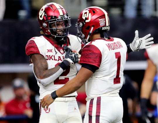 Could Oklahoma Sooners wide receiver CeeDee Lamb (2) and quarterback Kyler Murray (1) be reunited on the Arizona Cardinals? Some NFL mock draft projections think so.
