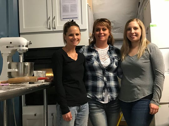 Homemade Pies by Kala co-owners Brooke Nielsen and Kala Sheridan and employee Sarah Alexander baked pies at the business's grand opening at 3 North Vines in Croswell on Nov. 27, 2019.