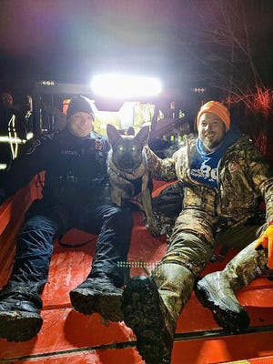Marysville Police Department K9 Officer Justin Reeves and police dog Heiko with a hunter they helped find who was lost in the Port Huron State Game Area on Nov. 30, 2019.