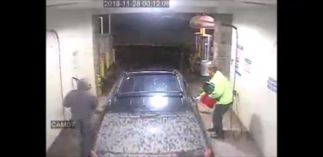 Security camera footage taken from a nearby car wash shows two suspects allegedly stealing a 2005 Dodge Caravan from Michigan Corvette & Classics AutoMaxx on Thanksgiving.