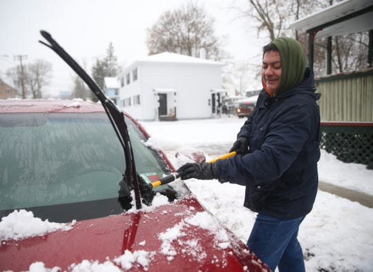 Luis Gonzalez scrape the ice off of his car  in the Village of Wappingers Falls on December 2, 2019.