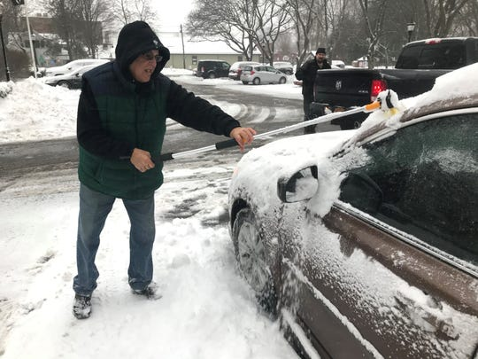Tom Hessler, 62, of Rhinebeck, clears snow from his car on Dec. 2, 2019.