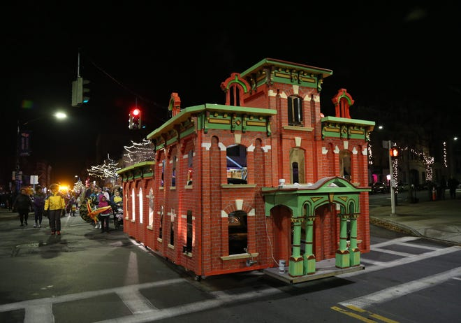 Scenes from the 2018 Celebration of Lights Parade in the City of Poughkeepsie features a float of the city's Cunneen-Hackett Arts Center.