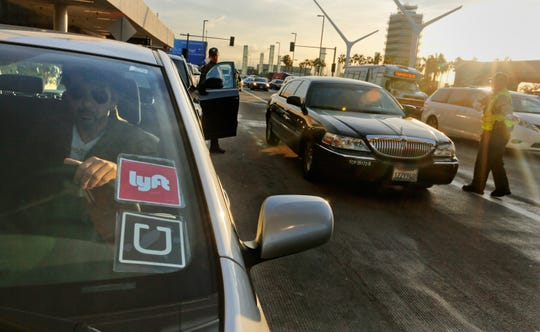 """A recent study by AAA contends that replacing a personal vehicle with ride-hailing services could amount to """"twice the cost of car ownership."""" (Mark Boster/Los Angeles Times/TNS)"""