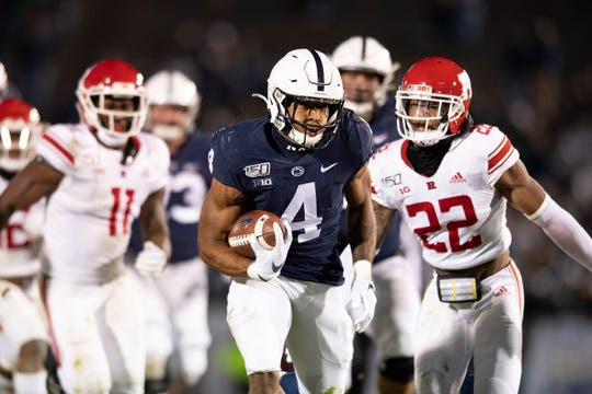 Penn State running back Journey Brown (4) eludes Rutgers defensive back Damon Hayes (22) in the second half of an NCAA college football game in State College, Pa., on Saturday, Nov. 30, 2019. (AP Photo/Barry Reeger)