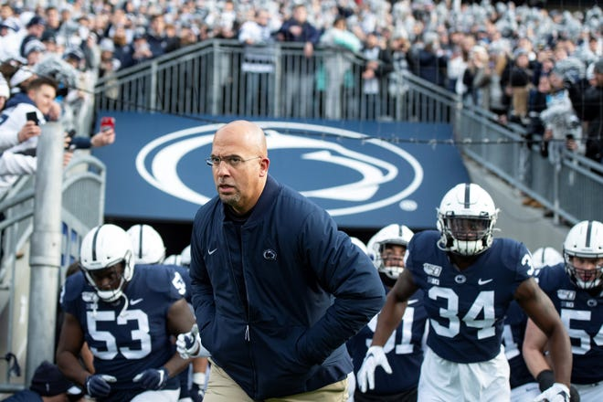 Penn State head coach James Franklin leads his team onto the field for an NCAA college football game against Rutgers in State College, Pa., on Saturday, Nov. 30, 2019. (AP Photo/Barry Reeger)