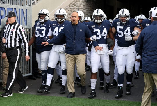 Penn State coach James Franklin, shown leading his team out of the tunnel before a game in November 2019, got a new, six-year contract starting in 2020.