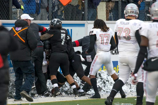 Nevada and UNLV players were involved in a postgame brawl in the south end zone at Mackay Stadium on Nov. 30.