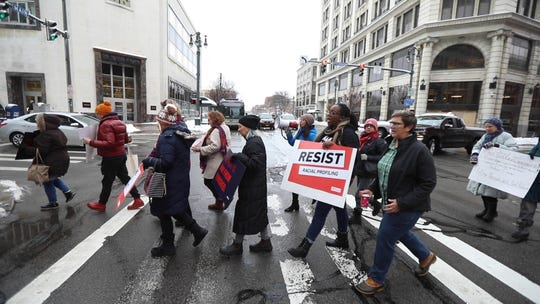 """Protesters against the """"annoyance"""" or harassment of police and emergency responders march from Downtown Presbyterian Church on Fitzhugh St. to the Monroe County Office Building on Main St."""