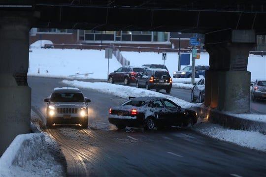 Cars on Elmwood Avenue near Wilson Boulevard in Rochester battle slick road conditions on Dec. 2, 2019.