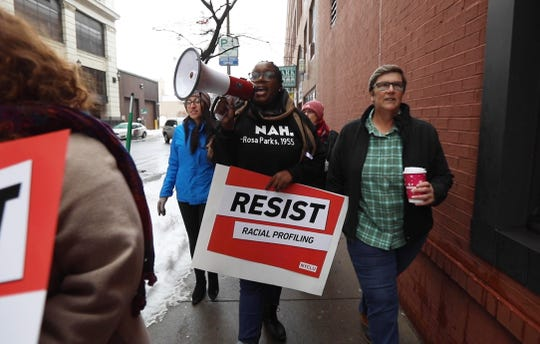 Ashley Gantt, with the NYCLU, and L.J. Fisher chant as they march towards the Monroe County Office Building.