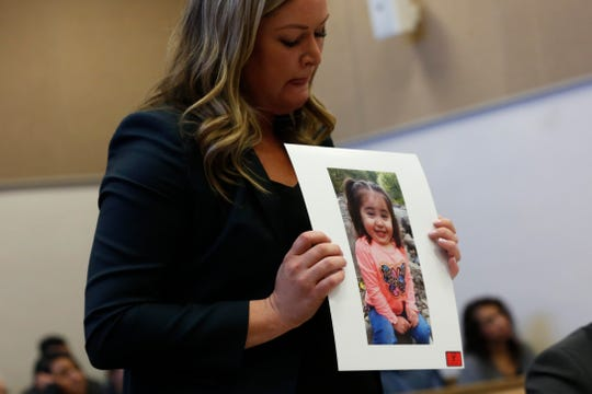 State prosecutor Ashley Cadotte holds a picture of Angelina Vazquez-Crisp, 2, who was killed in a crash caused by Favian Garcia during his sentencing at the Marion County Courthouse in Salem on Dec. 2, 2019. The picture was taken the same day she was killed.