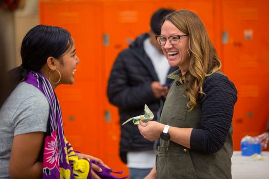 Woodshop and construction teacher Michelle Zielinski helps a student gather supplies during Woods II at McKay High School in Salem on Nov. 21.