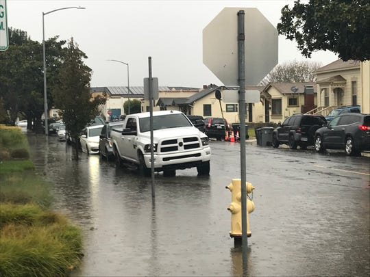 Water is reaching the doors of some vehicles on Church Street just north of West Gabilan Street Dec. 2, 2019.