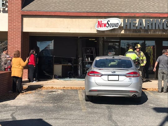 A vehicle collided into a business on Sherwood Way noon, Monday, Dec. 2, 2019. (License plate redacted.)