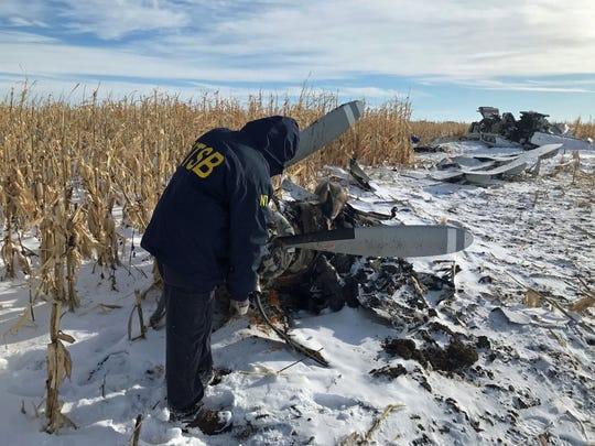 An NTSB air safety investigator examines the wreckage of the Pilatus PC-12 that crashed on Nov. 30, 2019,  shortly after departure from Chamberlain Municipal Airport. Nine people died.