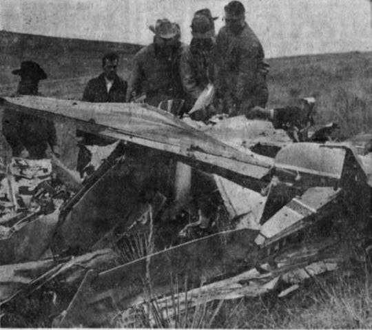 Rescuers search around a plane that crashed near Highmore, South Dakota in 1965.