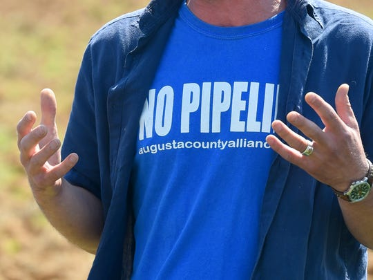 """The shirt of Staunton's Lorne Stockman, Oil Change International research analyst, reads, """"No Pipeline."""" Stockman brought in members of the Cowboy and Indian Alliance to Stuarts Draft to lead a ceremonial planting of, """"Seeds of Resistance,"""" corn sacred to the Ponca Nation, in the path of the proposed Atlantic Coast Pipeline with the help of landowners and others on Monday, June 6, 2016."""