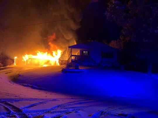 Fire engulfs a garage in Collegeville Township early Sunday, Dec. 1, 2019.
