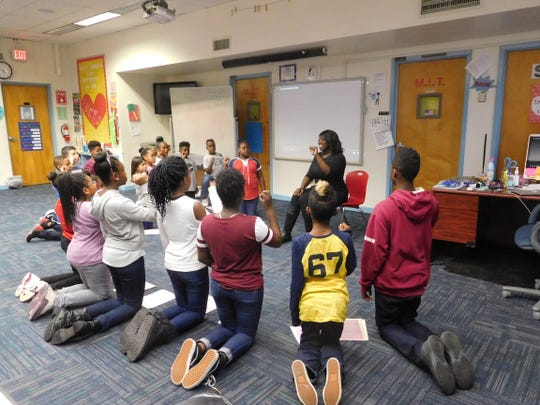 Arnekua Jackson encourages her students to sing with confidence.
