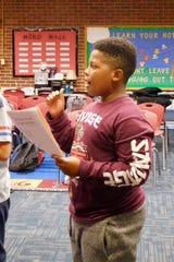 Singers greet rehearsal with vigor at Hartsfield Elementary.
