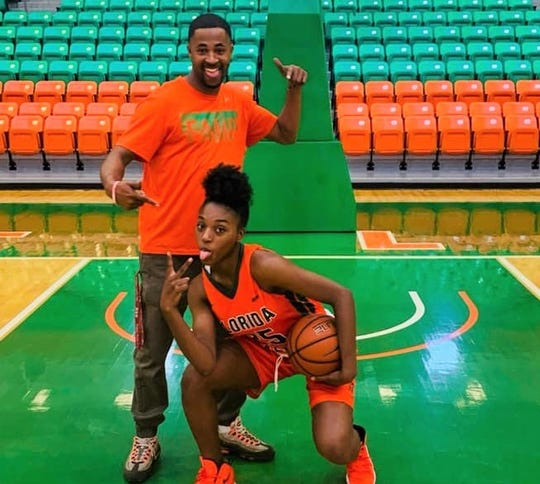 FAMU women's basketball head coach Kevin Lynum and newly-signed player Tyshonne Tollie celebrate her proud moment inside the Al Lawson Multipurpose Center.