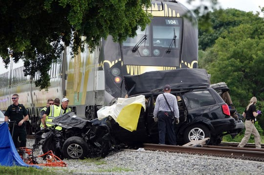Broward Sheriff's Deputies and Pompano Beach Fire Rescue work the scene of a fatal accident Aug. 25, 2019, on North Dixie Highway in Pompano Beach.  The Florida higher-speed passenger train service tied to Richard Branson's Virgin Group has the worst per-mile death rate in the U.S. The first death involving a Brightline train happened in July 2017 during test runs. An Associated Press analysis of Federal Railroad Administration data shows that since then, 40 more have been killed. That amounts to a rate of more than one a month and about one for every 29,000 miles the trains have traveled since the first death.