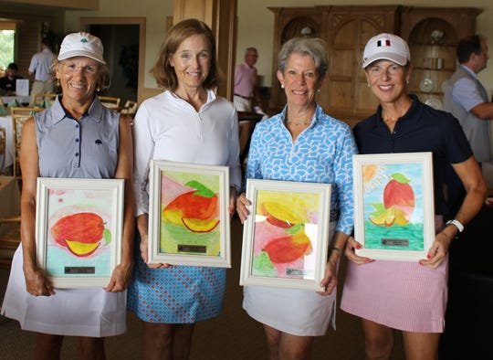The winning team of the Boys & Girls Clubs of Indian River County Nine Hole Tournament, from left,Susan Lawrence,Louise Huber,Judy Zern andKate Freeman with their prizes of custom artwork created by Sebastian Boys & Girls Club members.