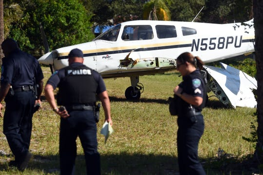 The pilot of a 2000 Piper Cherokee crash-landed the aircraft in a field in the 4100 block of Aviation Boulevard on Monday, Dec. 2, 2019, in Vero Beach. The pilot, Zhuang Qu, 22, was flying back from an airport in Okeechobee County when the aircraft lost power. The left wing was separated from the plane, but he managed to land it in an upright position.