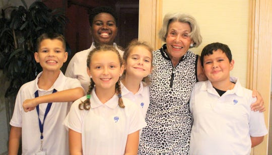 Boys & Girls Clubs of Indian River County Golf Committee member Nancy Lynch, second from right, congratulates the Club Kid members after their presentations during the Amateur Tournament at Bent Pine Golf Club on Nov.11, 2019.