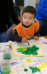 Ian Vazquez, 2, of Bridgeton enjoys painting during the Wee Read program at Cumberland County Library, 800 E. Commerce St., Bridgeton. For information, call (856) 453-2210.
