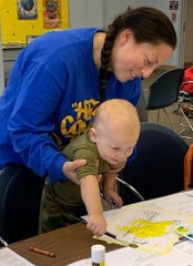 Hendrix Pereira, 1, of Bridgeton enjoys learning to paint with his mom during Wee Read at the Cumberland County Library, 800 E. Commerce St., Bridgeton. For information, call (856) 453-2210.