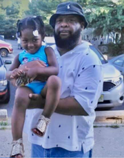 Fairfield resident Frank Najee-Ullah, seen here holding his granddaughter, was fatally shot at his home early Thanksgiving Day.