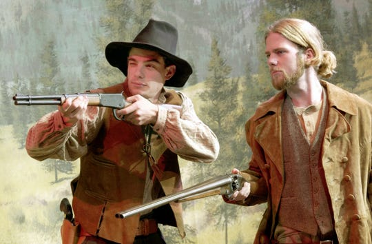 In this 2002 photo, Matthew Larsen, right, portrays John Sontag while Cane Summers plays Chris Evans, outlaws from Visalia's past.