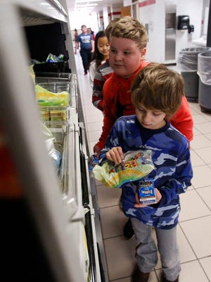 Students grab breakfast on Monday at Franklin Elementary School in Wausau. The school is able to provide free breakfast and lunch to every student, regardless of free or reduced-price status, through the USDA's Community Eligibility Provision.