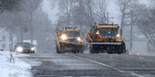 Snowplow drivers ride in tandem on Rt. 304 in Bardonia as snow falls Dec. 2, 2019.