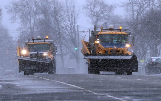 Snowplow drivers ride in tandem on Rt. 304 in Bardonia as snow falls Dec. 2, 2019.