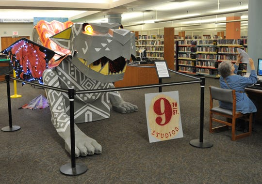 "The downtown Wichita Falls Public Library, located at 600 11th Street is thrilled to display ""Carol"" a brightly colored Alebrije.