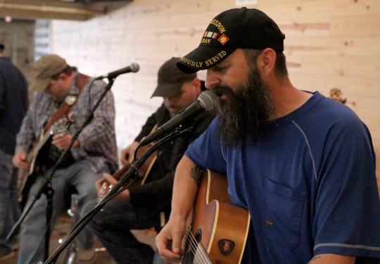 CJ Cody sings a Christmas song Sunday, Dec. 1, 2019, at the 6th Annual Holiday Canndemonium at The Warehouse.